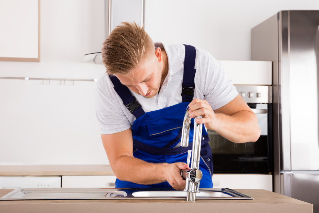 a plumber fixing the sink