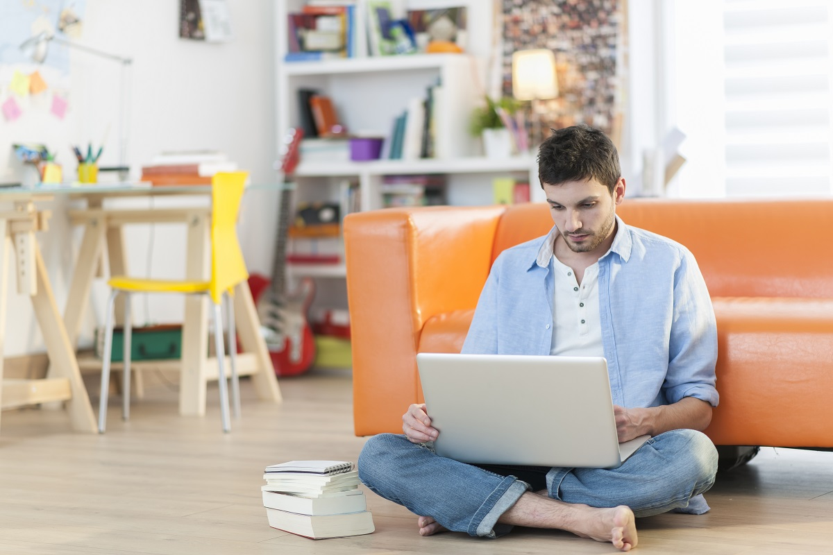 Man using laptop while sitting on the floor
