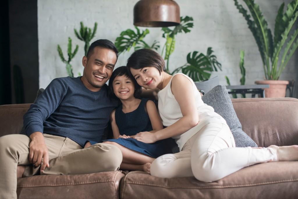 family of three in the living room