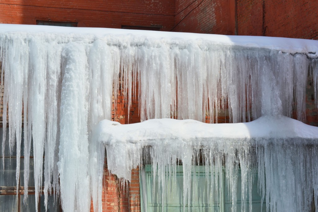 snow and ice on house exterior