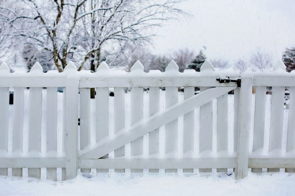 white picket fence snow