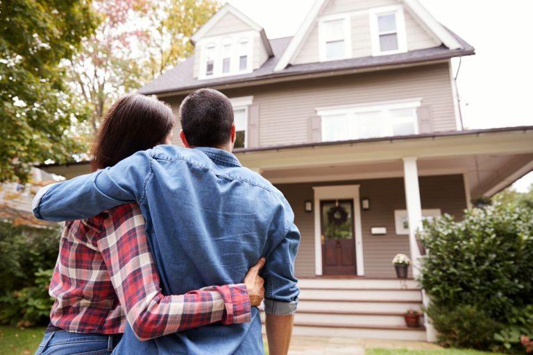 couple walking towards house
