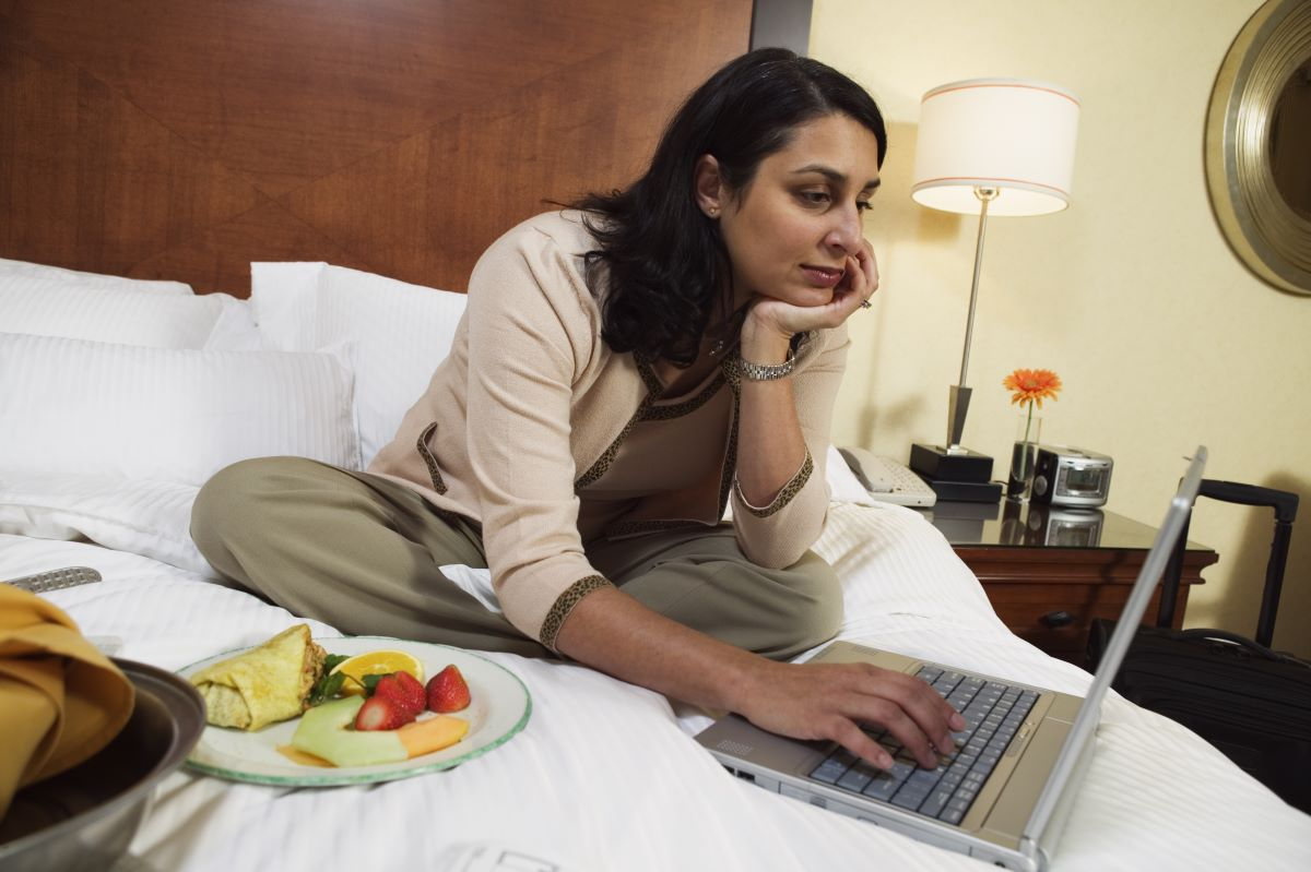 woman working on the bed