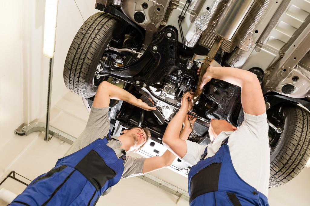 men repairing a car