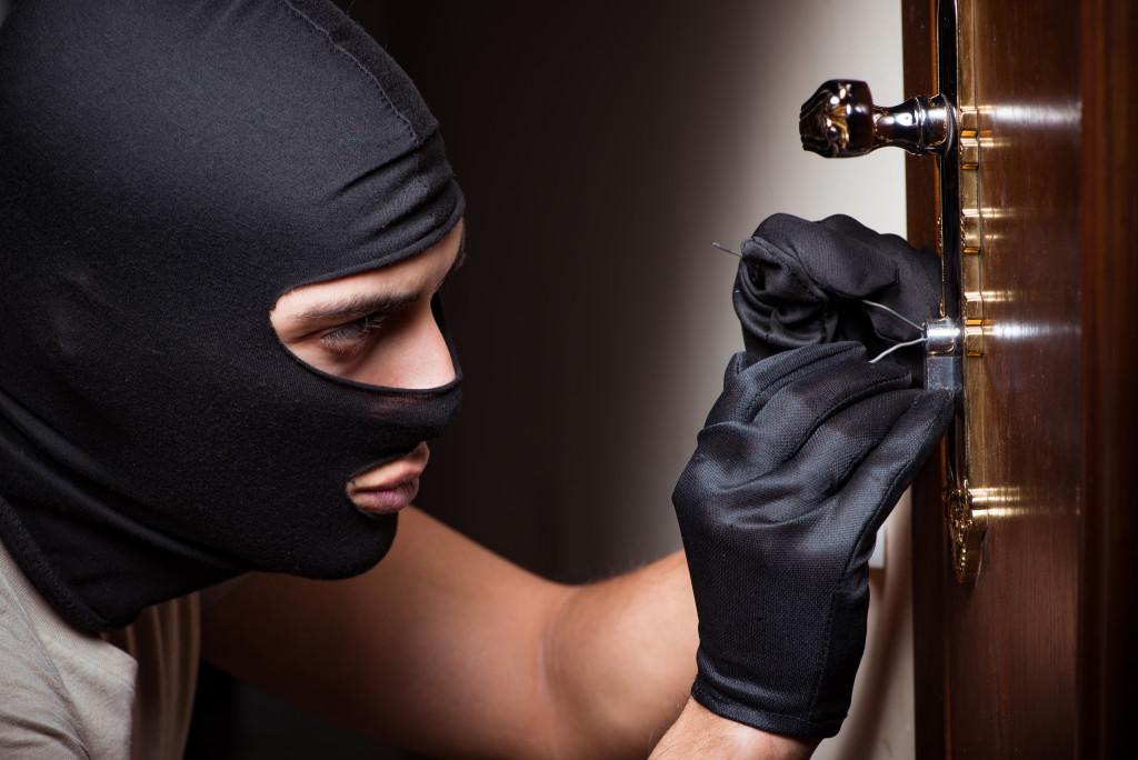 Man picking lock