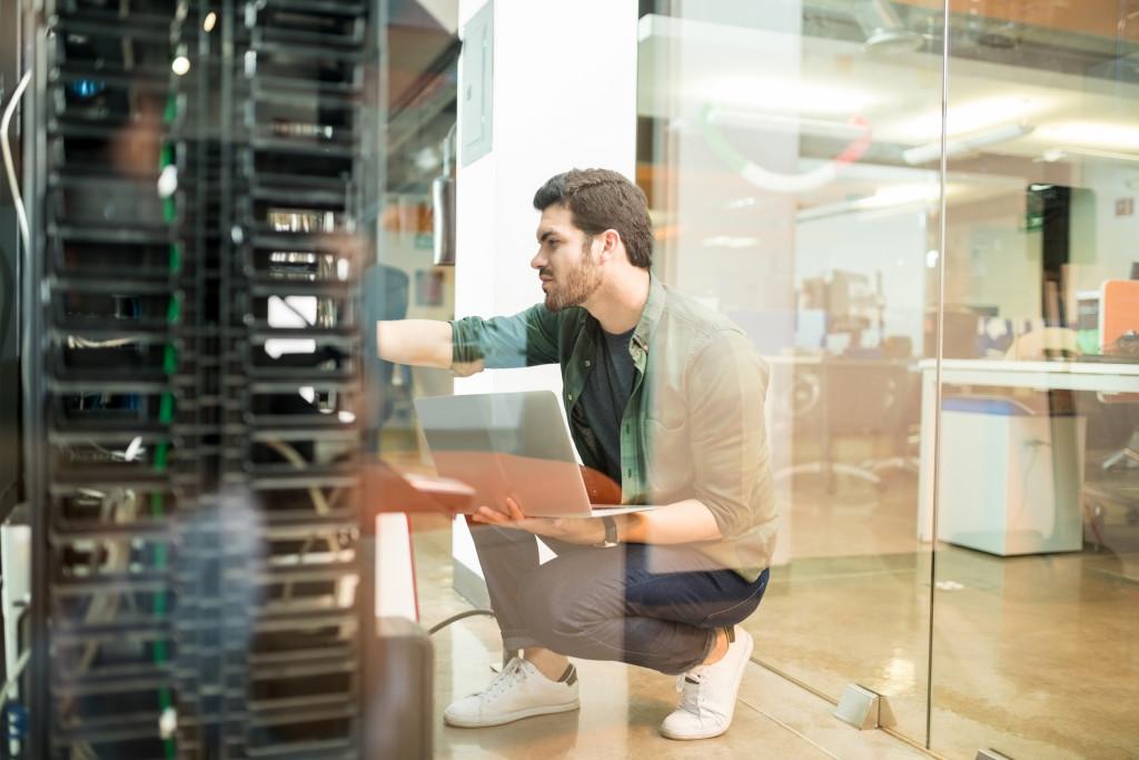Technician working on server