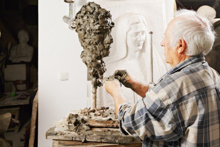 man sculpting customized figure