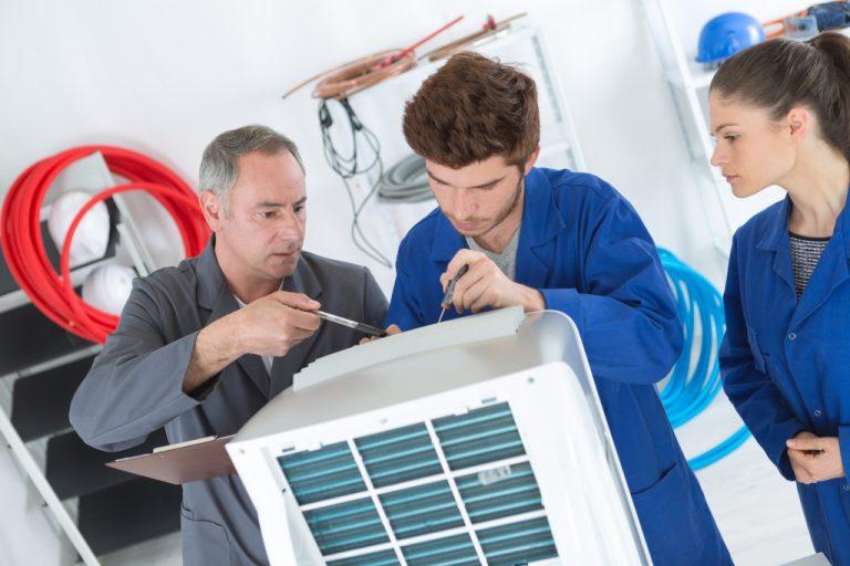 men doing equipment maintenance