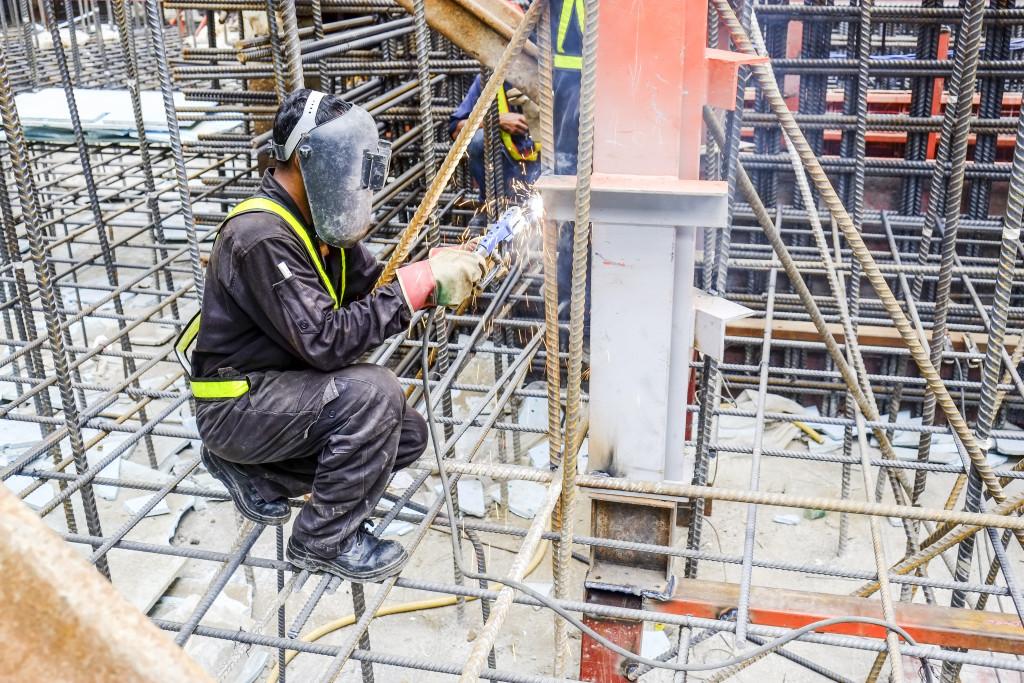 man welding rebar